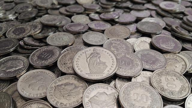stříbrné švýcarské mince